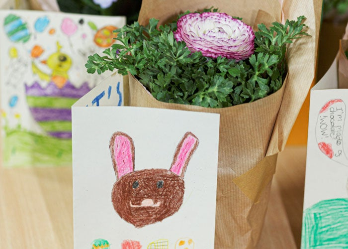 Close up of an Easter card and flowers
