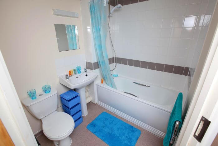 Bathroom in keyworker accommodation with bath and toilet