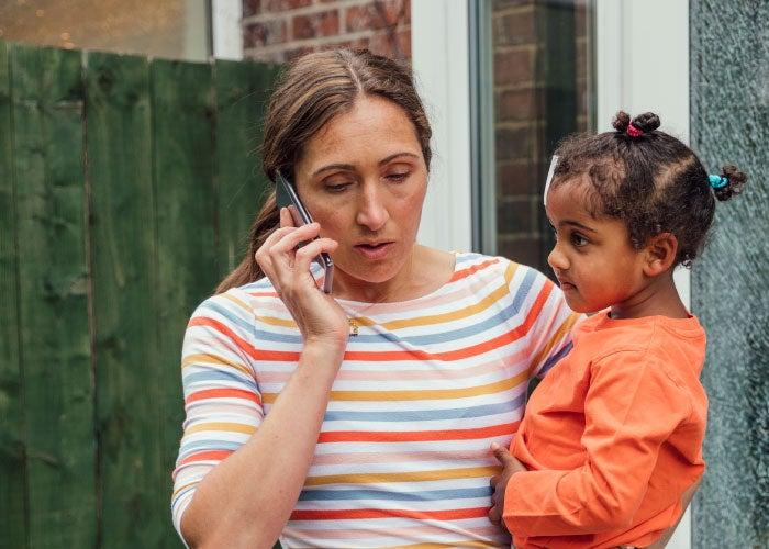 Anxious woman on phone