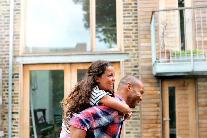 Man giving girl a piggy back
