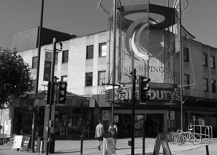 Black and white photograph of a shopping centre in Bristol