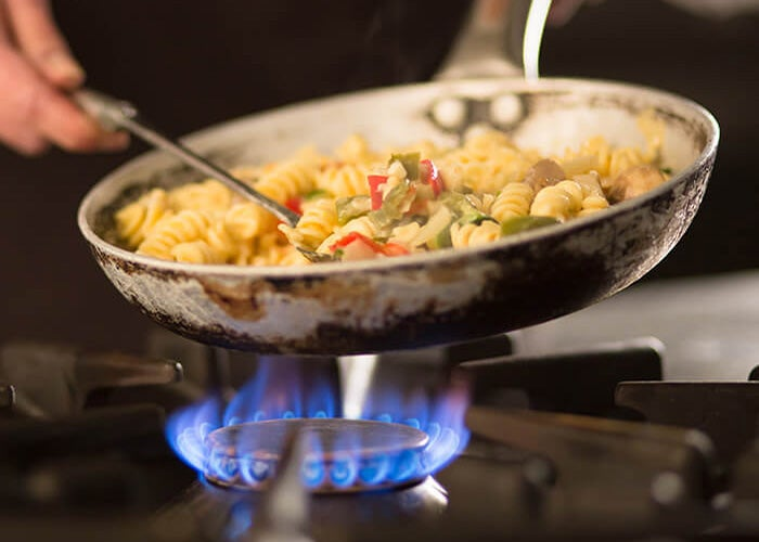 Cooking over a gas hob