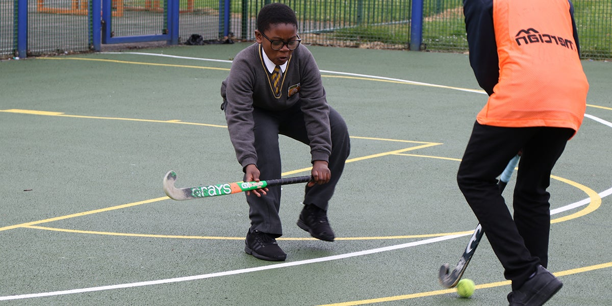 School Children playing hockey at Pollards Hill Youth Centre