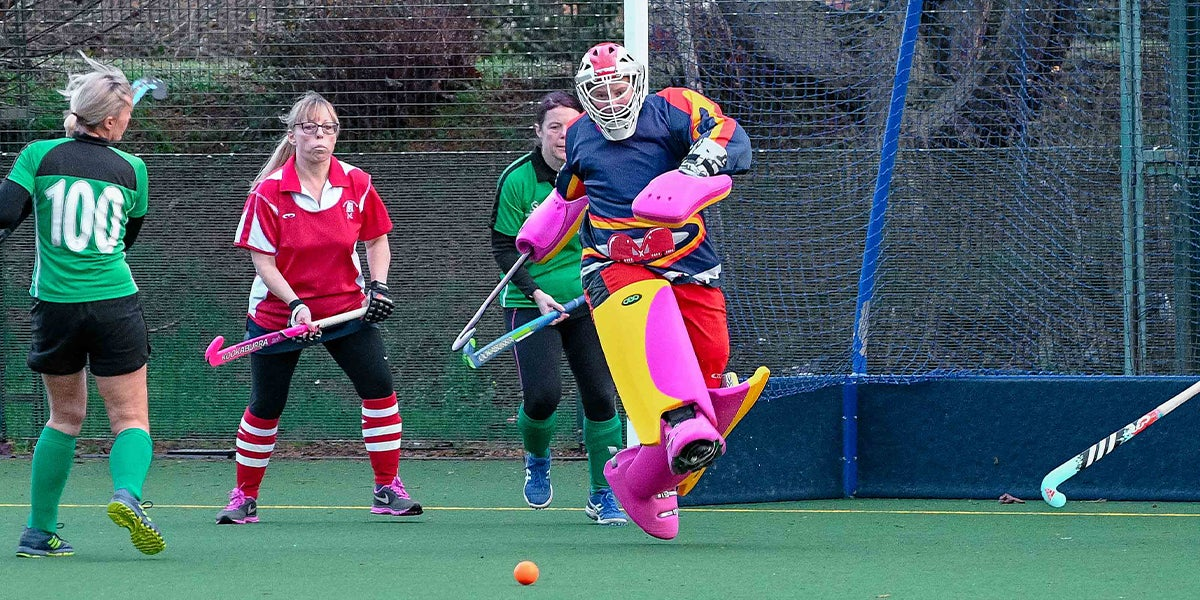 Newbury and Thatcham Hockey Club Goalie  kicking the ball making a save