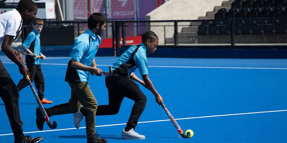 Young Players at Lee Valley Hockey and Tennis Centre playing Hockey