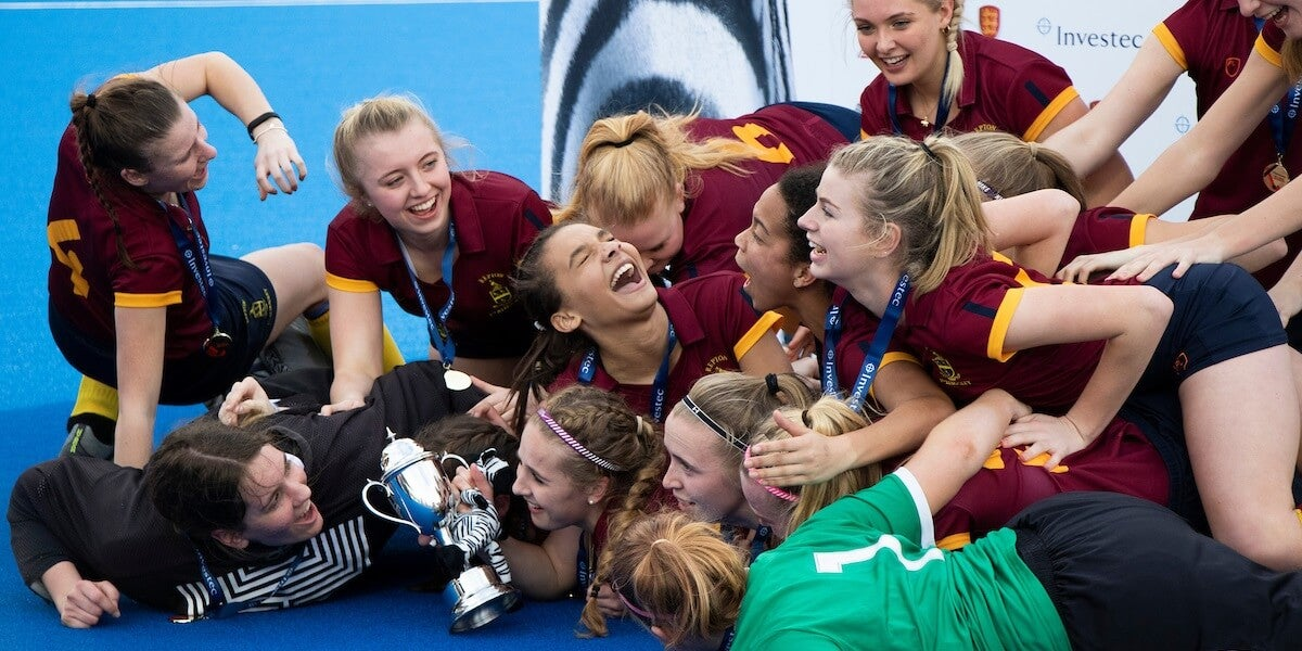 Girls Schools Championships - Girls smiling and laughing after winning
