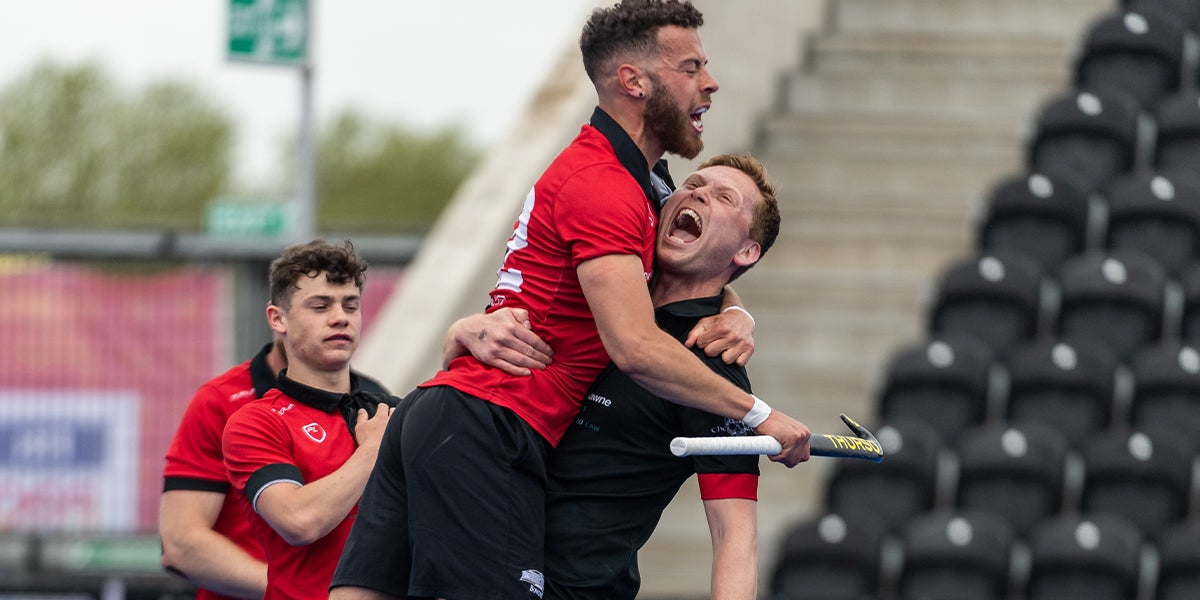 Male players celebrate winning at the England Hockey League Finals