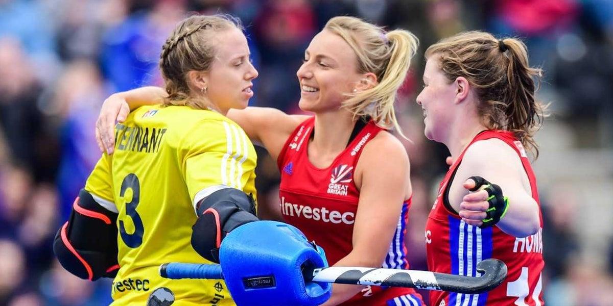 Amy Tennat hugs team mates Hannah martin and tess howard