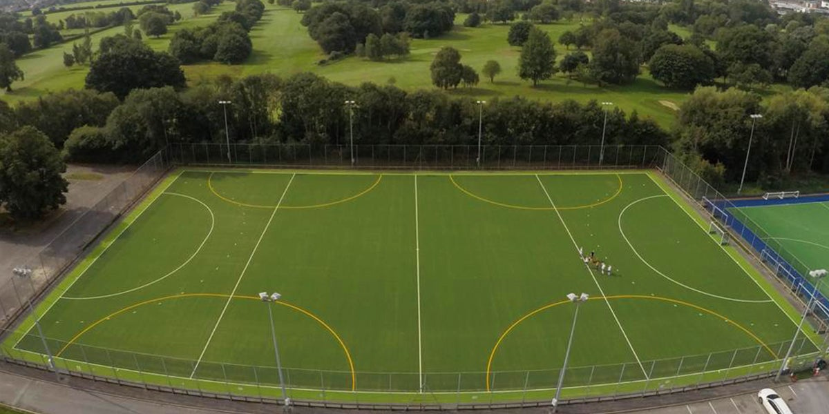Timperley hockey pitch - Green Pitch in surrounded by trees