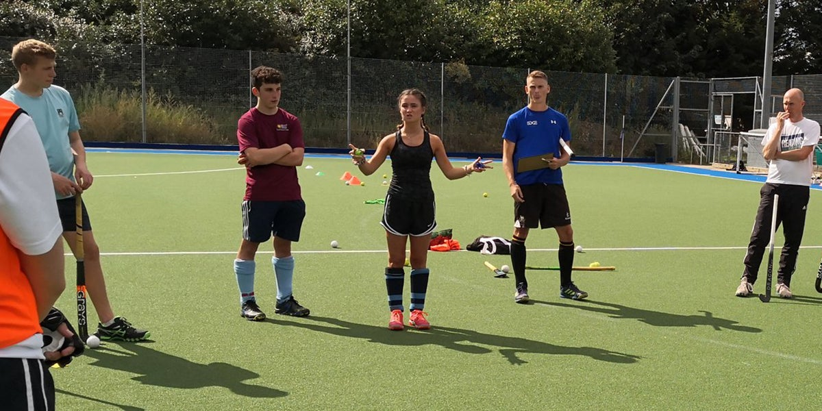 Female Coach Delivering a hockey session