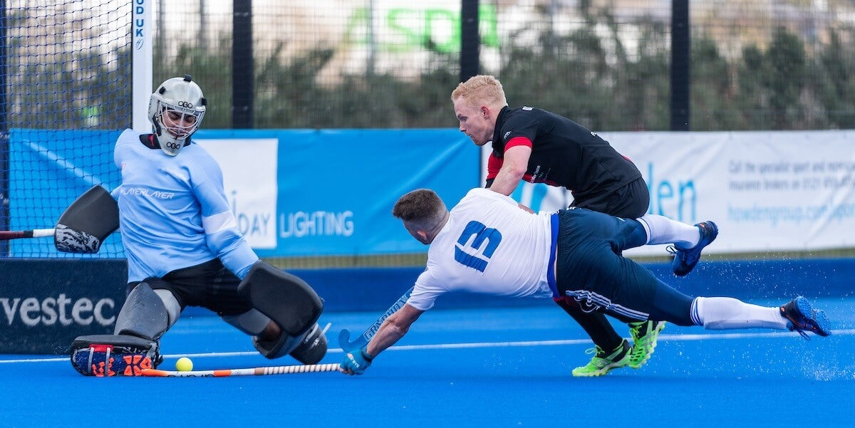 Diving across goal to score or save at the England Hockey League Finals