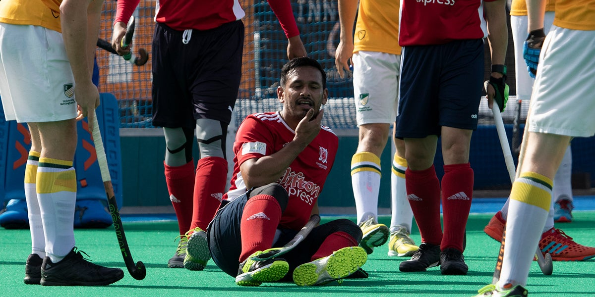 Hockey player holding his face