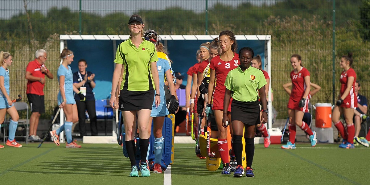 Two young female umpires at hockey futures cup