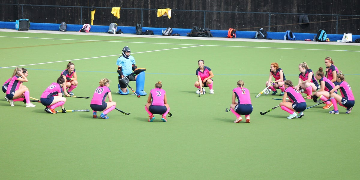 Hockey Squad socially distance huddle during COVID-19