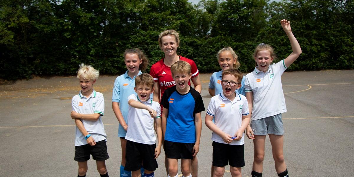 Ellie Rayer at junior school in maidenhead delivering Hockey