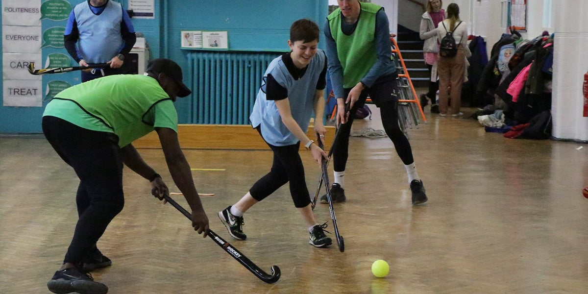 Team Up coaching session in a primary school in London. Teachers Playing Hockey