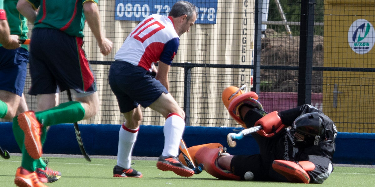 Goalie makes a save at England hockey championships