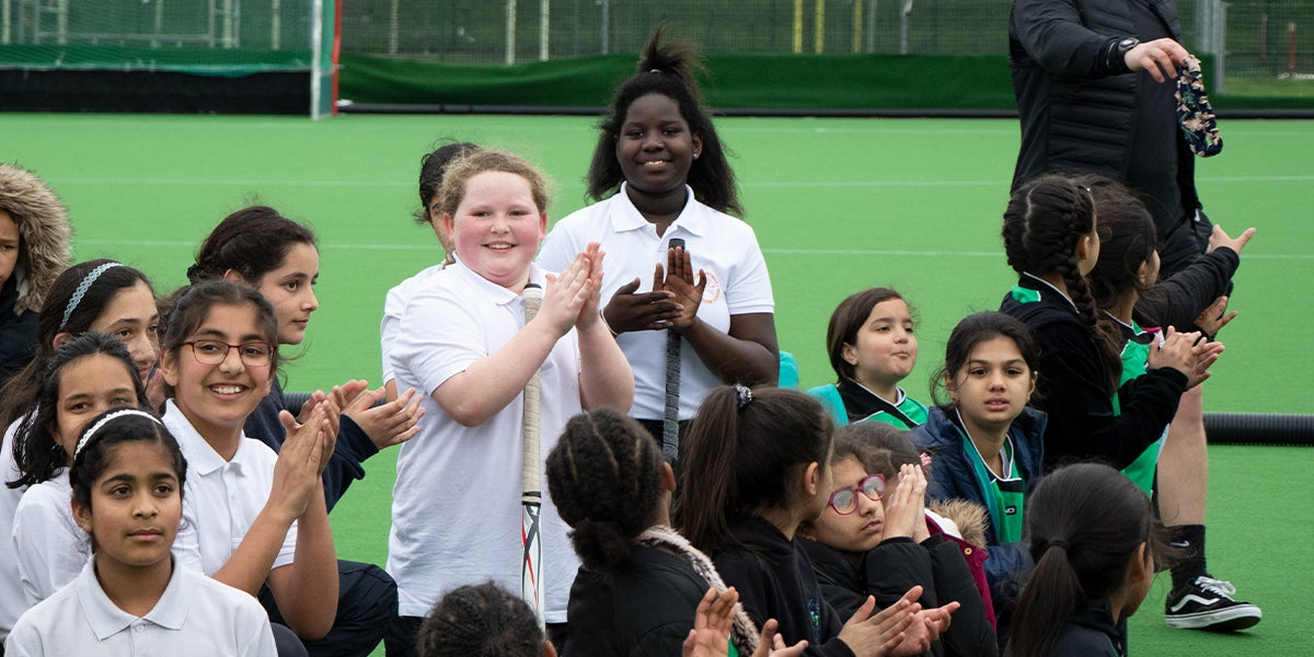 Young Girls smiling at hockey tournament in Slough