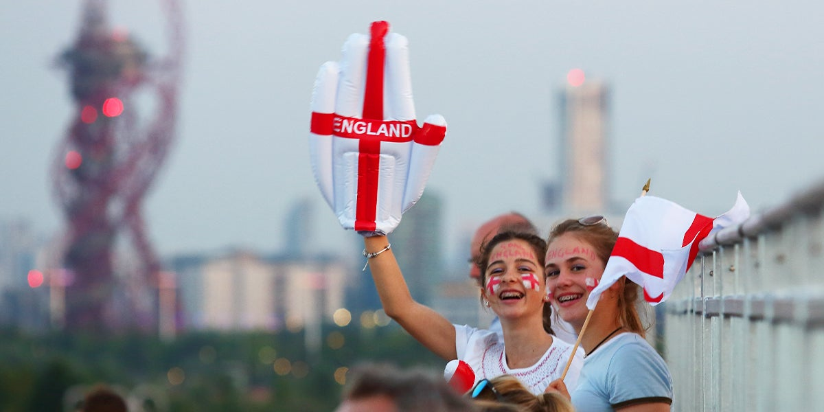 Girls waving England Flags and hand at Hockey Event
