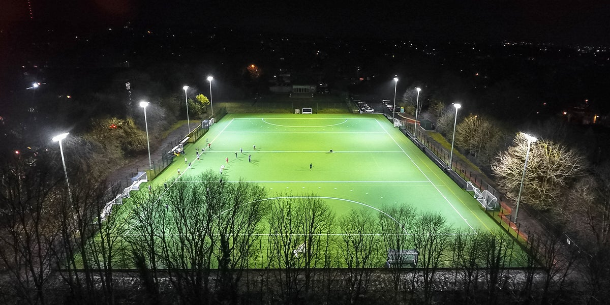 Bolton School  hockey pitch - Green Pitch in surrounded by trees