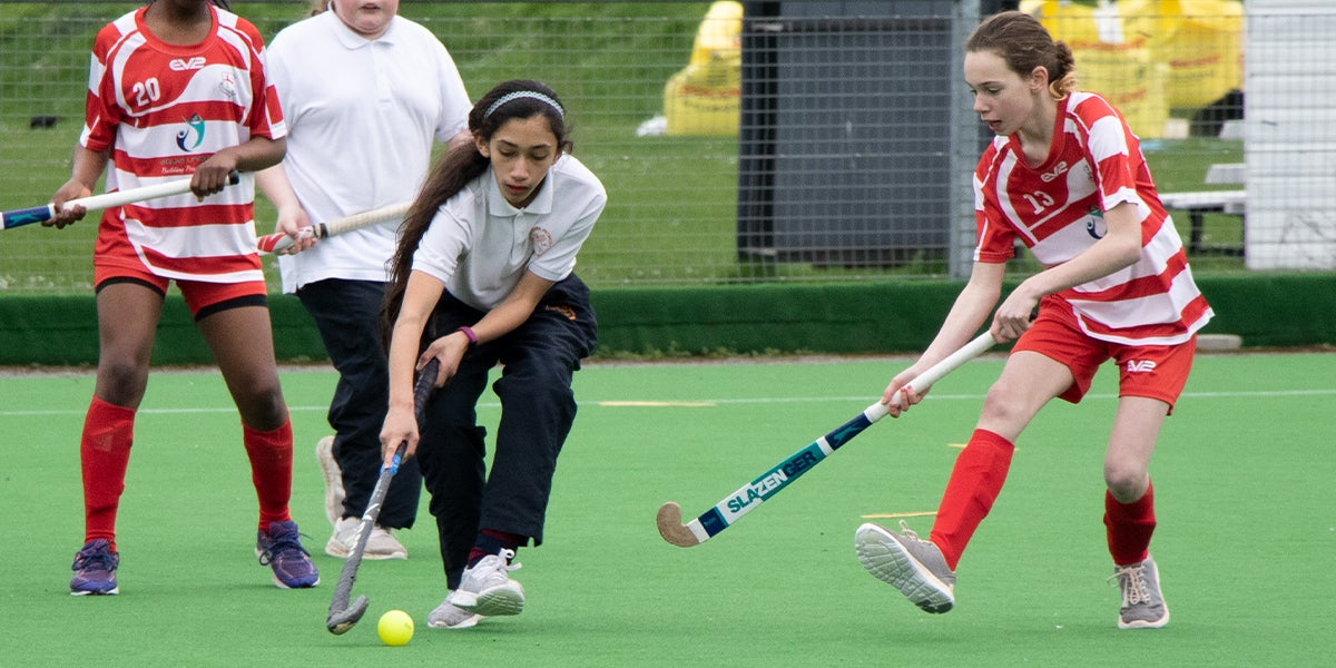 Slough Go Girls Tournament. Girls from Schools playing Hockey