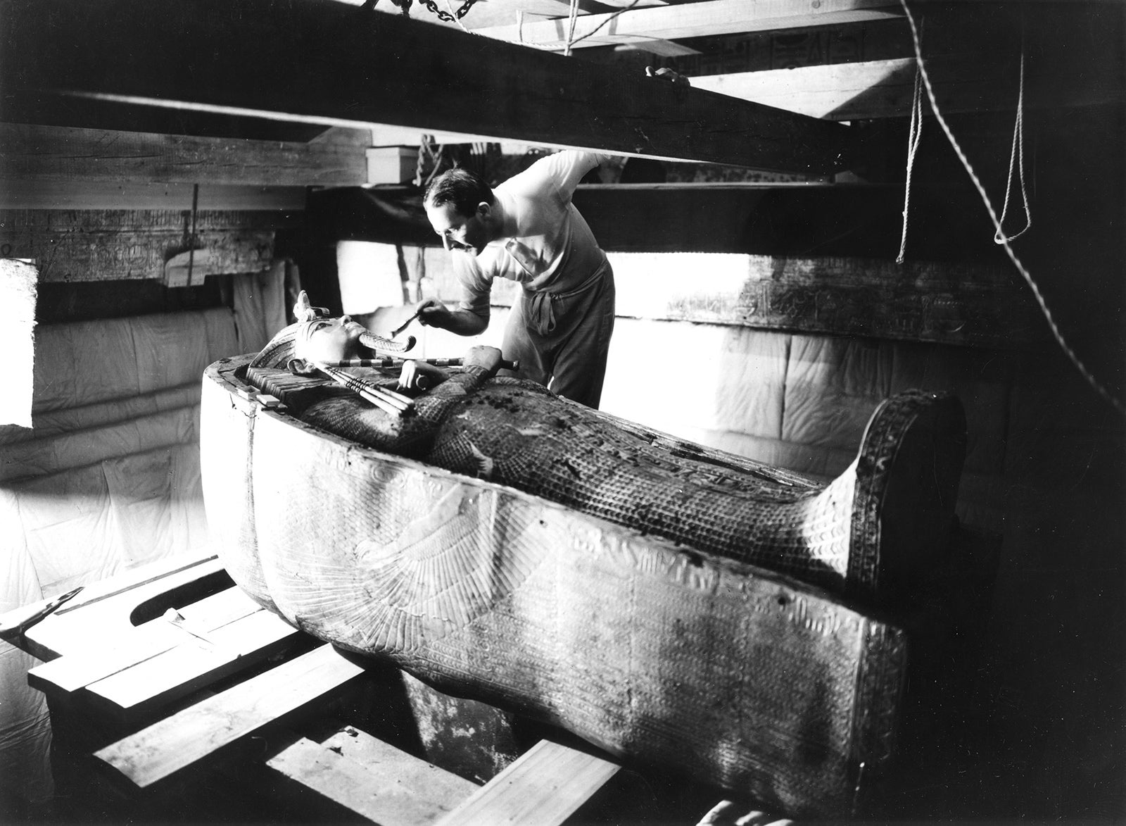 The British archaeologist Howard Carter in the tomb of Tutankhamun.