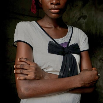 African woman with arms crossed.