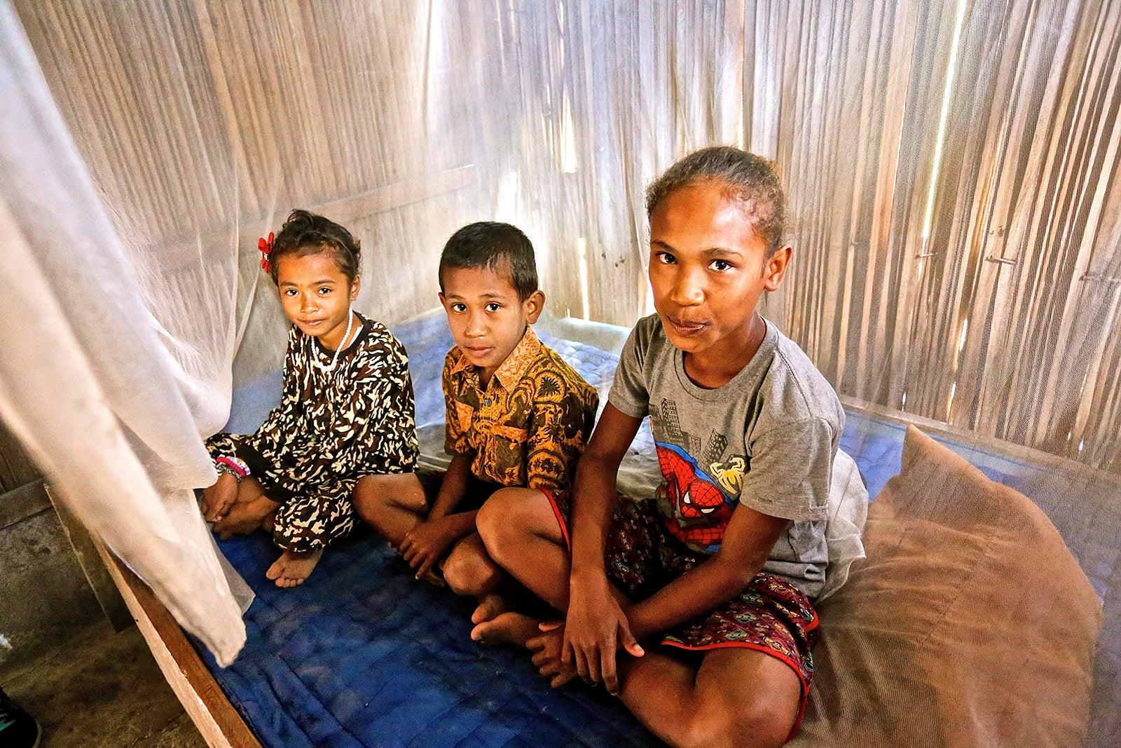 Three family members in a hospital in Timor Island. Credit: EOCRU.