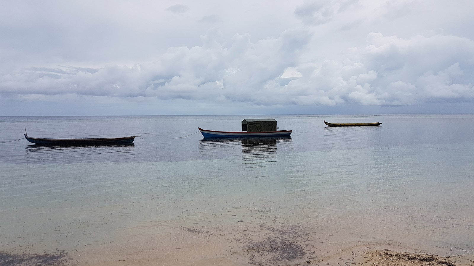 Beach and local fishing boats in Enggano