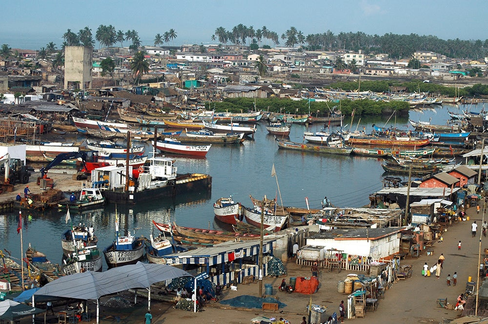 Boats and houses in Ghana. Credit: Shutterstock.