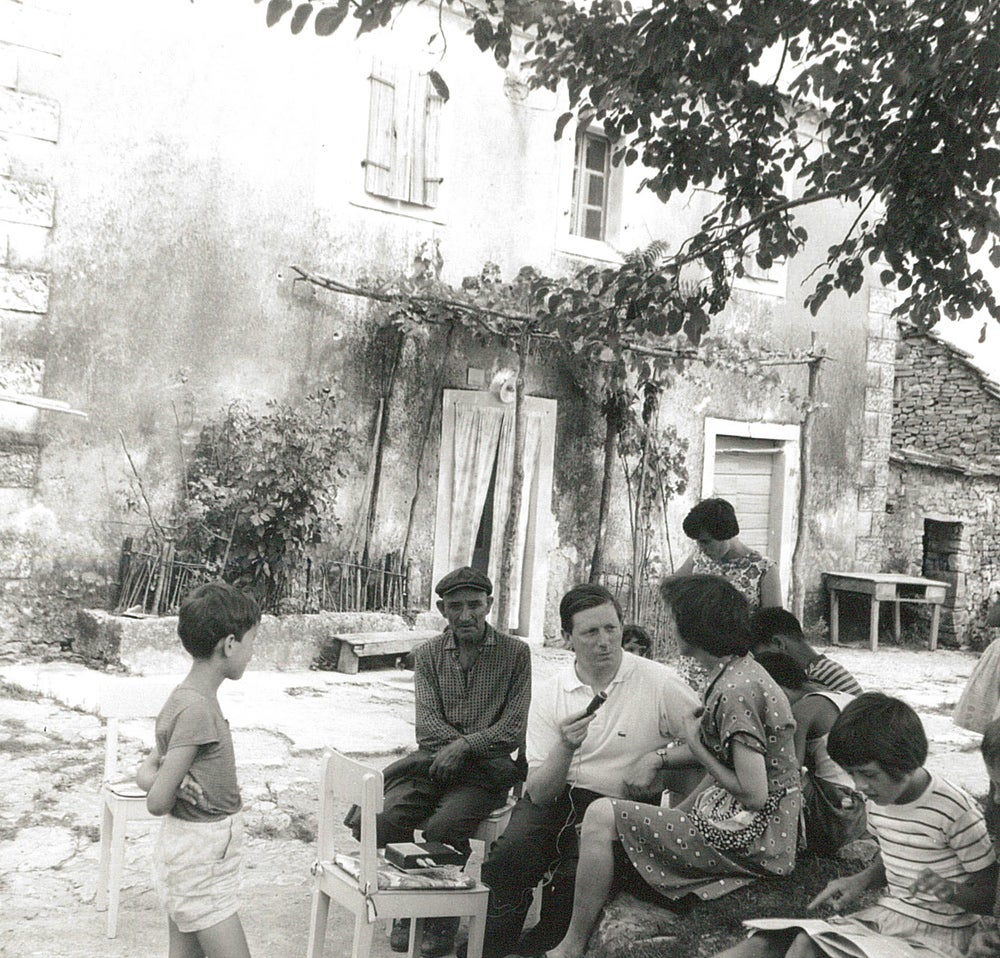Kostrčan, 1960s. Linguist Tony Hurren with a group of villagers. @V.A. Hurren.