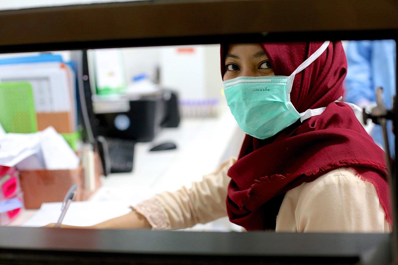 Researcher in a lab in Jakarta. Credit: EOCRU.