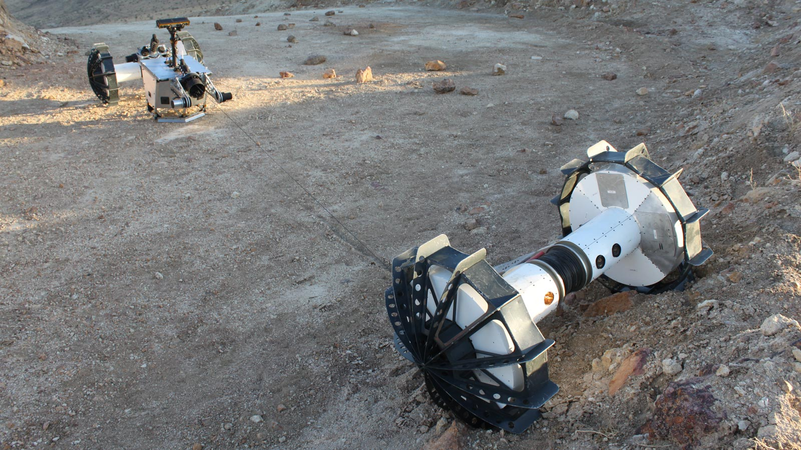 The DuAxel rover separates into two single-axled robots so that one can rappel down a slope too steep for conventional rovers. Image credit: NASA/JPL-Caltech/J.D. Gammell.